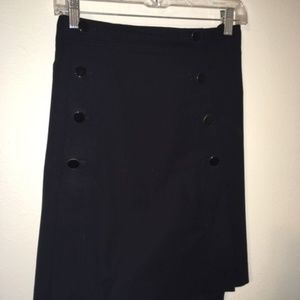Black sailor skirt with button detail.